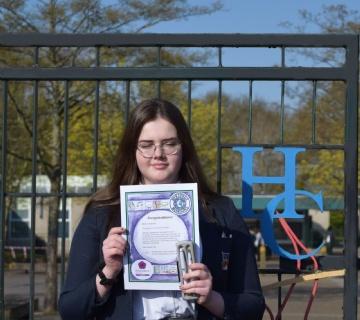 Melania receiving her award